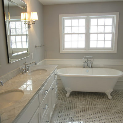 Bathroom - large traditional master gray tile and stone tile marble floor bathroom idea in Minneapolis with shaker cabinets, white cabinets, a two-piece toilet, gray walls, an undermount sink and marble countertops