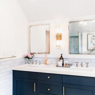 На фото: главная ванная комната среднего размера в стиле современная классика с фасадами с утопленной филенкой, синими фасадами, японской ванной, угловым душем, унитазом-моноблоком, синей плиткой, мраморной плиткой, белыми стенами, полом из мозаичной плитки, накладной раковиной, мраморной столешницей, синим полом и душем с распашными дверями с