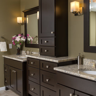 Inspiration for a large craftsman master beige tile and ceramic tile travertine floor bathroom remodel in Boston with an undermount sink, recessed-panel cabinets, dark wood cabinets, granite countertops, a two-piece toilet and green walls