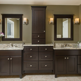 Large arts and crafts master beige tile and ceramic tile travertine floor bathroom photo in Boston with an undermount sink, recessed-panel cabinets, dark wood cabinets, granite countertops, a two-piece toilet and green walls