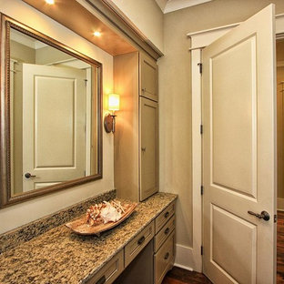 Example of a small master beige tile and ceramic tile ceramic floor bathroom design in Atlanta with an undermount sink, flat-panel cabinets, brown cabinets, quartz countertops and beige walls