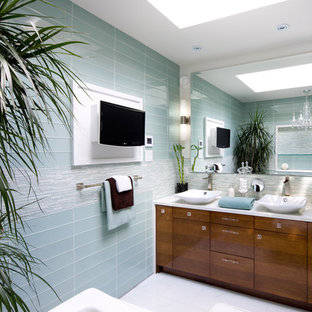 This is an example of a contemporary bathroom in Toronto with a vessel sink, blue tile and glass tile.