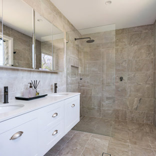 This is an example of a contemporary bathroom in Sydney with shaker cabinets, white cabinets, a curbless shower, beige tile, an undermount sink, beige floor, an open shower and white benchtops.