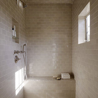 Inspiration for a mediterranean bathroom in San Francisco with beige tiles, metro tiles, a wall niche and a shower bench.