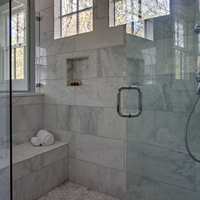 Inspiration for a large rustic master white tile marble floor freestanding bathtub remodel in Nashville with an undermount sink, recessed-panel cabinets and dark wood cabinets