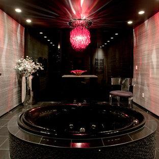 Drop-in bathtub - contemporary gray tile drop-in bathtub idea in Seattle with a vessel sink