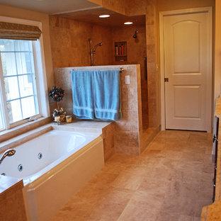 ポートランドの中サイズのトラディショナルスタイルのおしゃれなマスターバスルーム (レイズドパネル扉のキャビネット、中間色木目調キャビネット、アルコーブ型浴槽、ダブルシャワー、ベージュのタイル、セラミックタイル、ベージュの壁、セラミックタイルの床、オーバーカウンターシンク、御影石の洗面台、ベージュの床、オープンシャワー、ベージュのカウンター) の写真