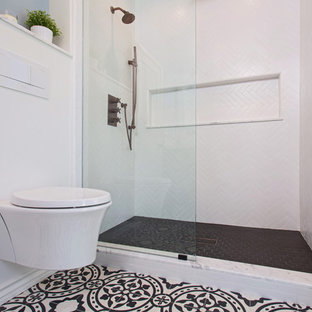 Alcove shower - mid-sized scandinavian 3/4 white tile and porcelain tile cement tile floor and black floor alcove shower idea in Los Angeles with furniture-like cabinets, black cabinets, a wall-mount toilet, gray walls, an undermount sink, marble countertops and a hinged shower door
