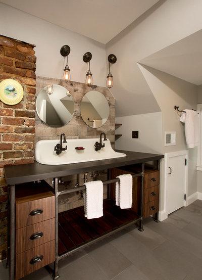 Luxury Industrial Bathroom by Four Brothers LLC