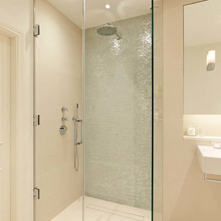 Design ideas for a large contemporary master bathroom in London with a corner shower, beige walls and metal tile.