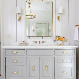 Transitional white floor, single-sink and shiplap wall bathroom photo in Atlanta with shaker cabinets, gray cabinets, white walls, an undermount sink, white countertops and a built-in vanity