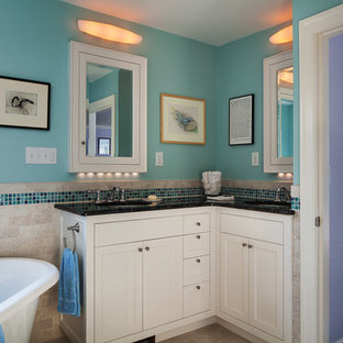 Example of a mid-sized classic 3/4 blue tile and mosaic tile ceramic floor bathroom design in Boston with an undermount sink, shaker cabinets, white cabinets, granite countertops, a two-piece toilet and blue walls