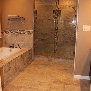 ワシントンD.C.の巨大なトランジショナルスタイルのおしゃれなマスターバスルーム (アンダーカウンター洗面器、シェーカースタイル扉のキャビネット、濃色木目調キャビネット、御影石の洗面台、大型浴槽、ダブルシャワー、分離型トイレ、茶色いタイル、セラミックタイル、茶色い壁、セラミックタイルの床) の写真