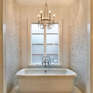 Example of a mid-sized classic master white tile and mosaic tile marble floor freestanding bathtub design in Chicago with white walls