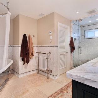 Freestanding bathtub - coastal freestanding bathtub idea in Orange County with shaker cabinets
