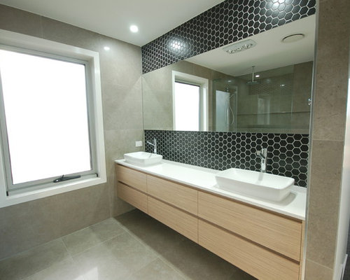 bathroom in brisbane with black tile mosaic tile and mosaic tile