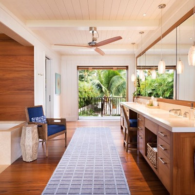 Inspiration for a large tropical master white tile and stone slab dark wood floor and brown floor alcove shower remodel in Hawaii with flat-panel cabinets, medium tone wood cabinets, an undermount tub, white walls, an integrated sink and quartz countertops