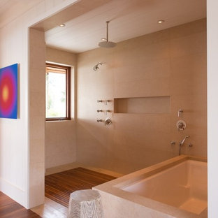 Design ideas for a large world-inspired ensuite bathroom in Hawaii with flat-panel cabinets, medium wood cabinets, a submerged bath, a walk-in shower, white walls, medium hardwood flooring, an integrated sink and engineered stone worktops.