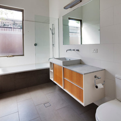 Example of a mid-sized trendy white tile porcelain tile bathroom design in Perth with a vessel sink, marble countertops, a two-piece toilet, white walls, flat-panel cabinets and medium tone wood cabinets