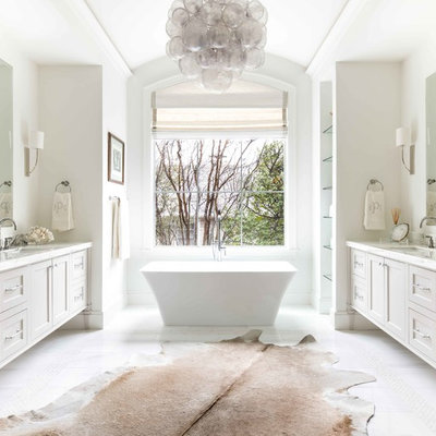 Inspiration for a coastal master white floor freestanding bathtub remodel in Dallas with furniture-like cabinets, gray cabinets, white walls, an undermount sink and white countertops