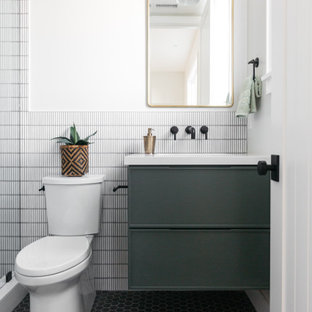 Inspiration for a farmhouse master marble tile and white tile mosaic tile floor, black floor and single-sink bathroom remodel in Los Angeles with an undermount sink, quartz countertops, white countertops, flat-panel cabinets, green cabinets, a two-piece toilet, white walls and a floating vanity