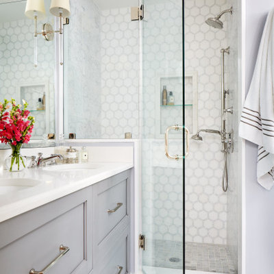 Mid-sized transitional master gray tile and mosaic tile marble floor and gray floor alcove shower photo in DC Metro with recessed-panel cabinets, gray cabinets, gray walls, an undermount sink, quartzite countertops, a hinged shower door and white countertops
