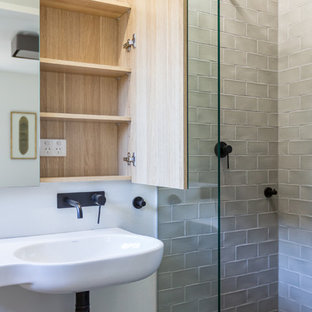 Photo of a small traditional shower room bathroom in Sydney with glass-front cabinets, light wood cabinets, an alcove shower, a one-piece toilet, grey tiles, ceramic tiles, white walls, slate flooring, a wall-mounted sink, black floors and an open shower.