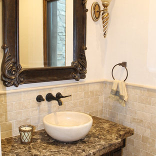 Photo of a small mediterranean shower room bathroom in San Luis Obispo with a vessel sink, freestanding cabinets, dark wood cabinets, marble worktops, beige tiles, stone tiles and beige walls.