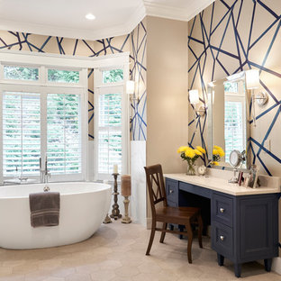 Example of a huge transitional master ceramic tile and beige floor freestanding bathtub design in Nashville with blue cabinets, multicolored walls, quartzite countertops, furniture-like cabinets and beige countertops