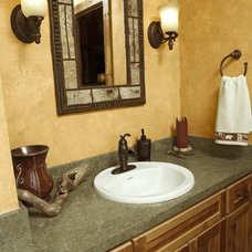 Rustic Bathroom by mackmiller design+build