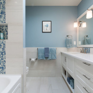 Design ideas for a traditional bathroom in Vancouver with white cabinets, beige floors and white worktops.