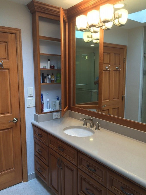portland with louvered cabinets medium wood cabinets an alcove bath