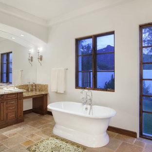 Freestanding bathtub - mediterranean freestanding bathtub idea in Phoenix with granite countertops