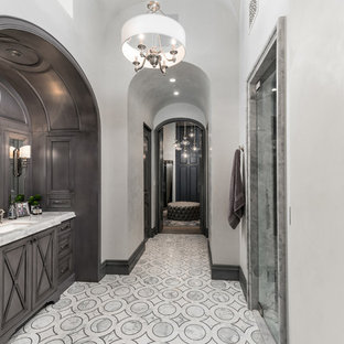 Huge tuscan master porcelain floor and white floor bathroom photo in Phoenix with furniture-like cabinets, quartzite countertops, a hinged shower door, gray cabinets, white walls, an undermount sink and gray countertops