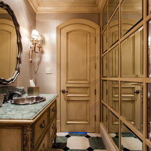 Tuscan multicolored floor bathroom photo in Orange County with furniture-like cabinets, beige cabinets, beige walls, a drop-in sink and green countertops