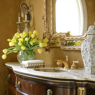 Bathroom - mediterranean bathroom idea in Little Rock with an undermount sink and dark wood cabinets