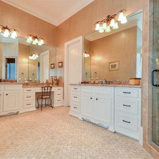 Imagen de cuarto de baño principal, mediterráneo, grande, con armarios con paneles empotrados, puertas de armario blancas, bañera encastrada, ducha empotrada, baldosas y/o azulejos rosa, baldosas y/o azulejos de mármol, paredes rosas, suelo de baldosas de porcelana, lavabo encastrado, encimera de granito, suelo blanco, ducha con puerta con bisagras y encimeras rosas