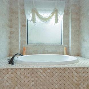 Foto de cuarto de baño principal, mediterráneo, grande, con armarios con paneles empotrados, puertas de armario blancas, bañera encastrada, ducha empotrada, baldosas y/o azulejos rosa, baldosas y/o azulejos de mármol, paredes rosas, suelo de baldosas de porcelana, lavabo encastrado, encimera de granito, suelo blanco, ducha con puerta con bisagras y encimeras rosas