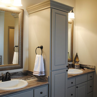 Inspiration for a medium sized mediterranean ensuite bathroom in Austin with a built-in sink, recessed-panel cabinets, brown cabinets, laminate worktops, a built-in bath, a corner shower, a two-piece toilet, beige walls and vinyl flooring.