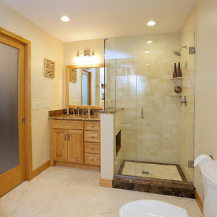 Photo of a medium sized mediterranean ensuite bathroom in Chicago with raised-panel cabinets, light wood cabinets, a built-in bath, a corner shower, a two-piece toilet, white walls, a submerged sink, granite worktops and a hinged door.