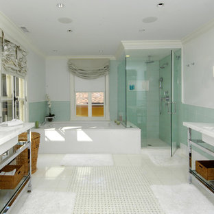 Mediterranean bathroom in New York with a submerged sink, a submerged bath, a corner shower, green tiles and glass tiles.
