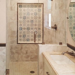 Mid-sized tuscan master multicolored tile and mosaic tile marble floor bathroom photo in San Francisco with recessed-panel cabinets, white cabinets, beige walls, an undermount sink and marble countertops