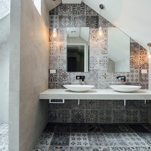 Photo of a mid-sized contemporary master bathroom in Sydney with an open shower, gray tile, stone tile, grey walls, cement tiles, a vessel sink, marble benchtops and an open shower.
