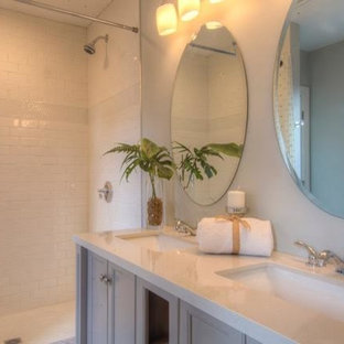 Example of a mid-sized transitional 3/4 white tile and subway tile medium tone wood floor and brown floor bathroom design in Boston with recessed-panel cabinets, gray cabinets, gray walls, an undermount sink, quartz countertops and white countertops