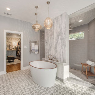 Large eclectic master gray tile and cement tile cement tile floor bathroom photo in Dallas with flat-panel cabinets, light wood cabinets, a two-piece toilet, gray walls, an undermount sink and quartzite countertops