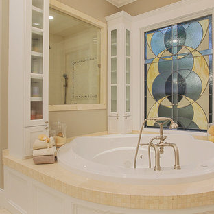 Design ideas for a classic bathroom in Houston with a corner shower, beige tiles, mosaic tiles and a hot tub.