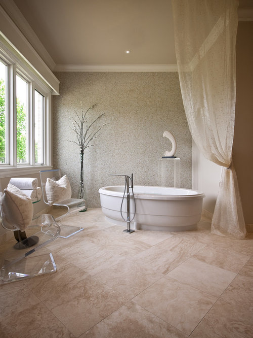 Inspiration for a contemporary mosaic tile and beige tile travertine floor  freestanding bathtub remodel in Austin