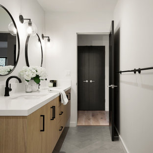 Example of a small minimalist kids' white tile and ceramic tile porcelain tile, gray floor and double-sink alcove shower design in San Francisco with flat-panel cabinets, white cabinets, a one-piece toilet, white walls, a drop-in sink, quartz countertops, a hinged shower door, white countertops, a niche and a floating vanity