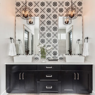 Drop-in bathtub - farmhouse master black and white tile and cement tile porcelain floor drop-in bathtub idea in Boise with shaker cabinets, black cabinets, white walls, a vessel sink and engineered quartz countertops