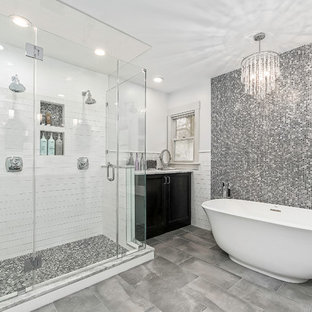 Bathroom - transitional master black and white tile, gray tile and mosaic tile gray floor and porcelain floor bathroom idea in Columbus with recessed-panel cabinets, black cabinets, white walls and a hinged shower door